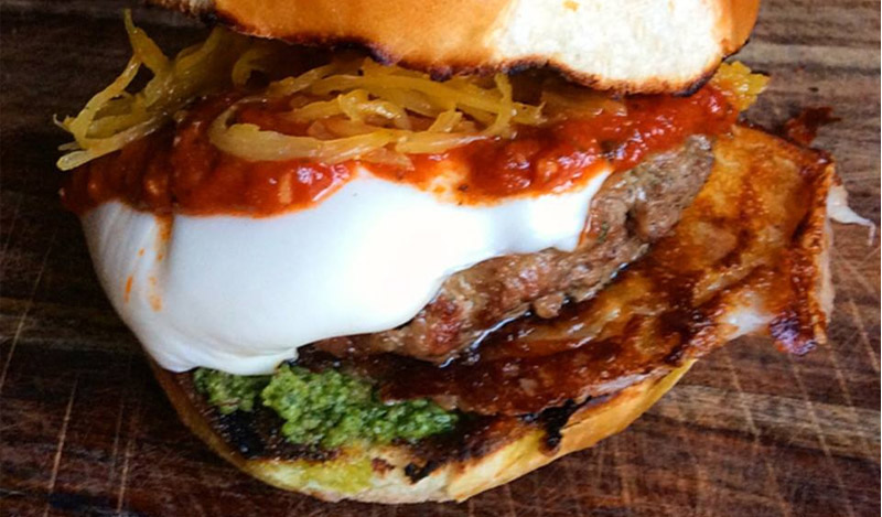 Grilled Meatball Burger with Pesto and Spicy Marinara on a Brioche Roll