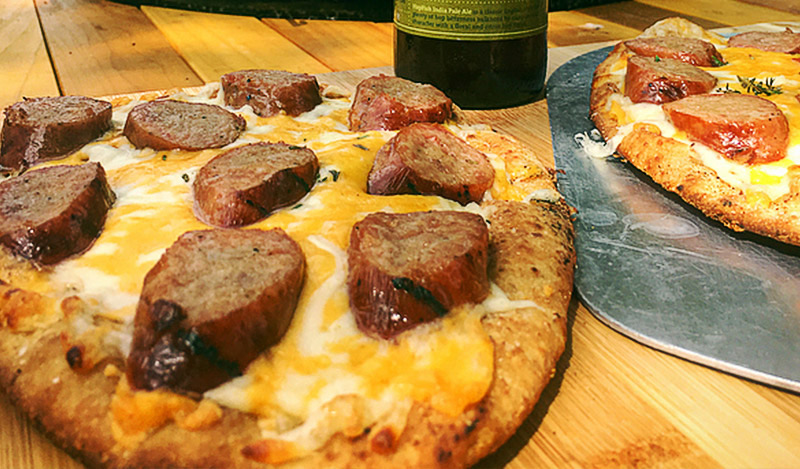 Grilled Hatfield Cheddar and Flying Fish Ale Bratwurst pizzas on Naan bread