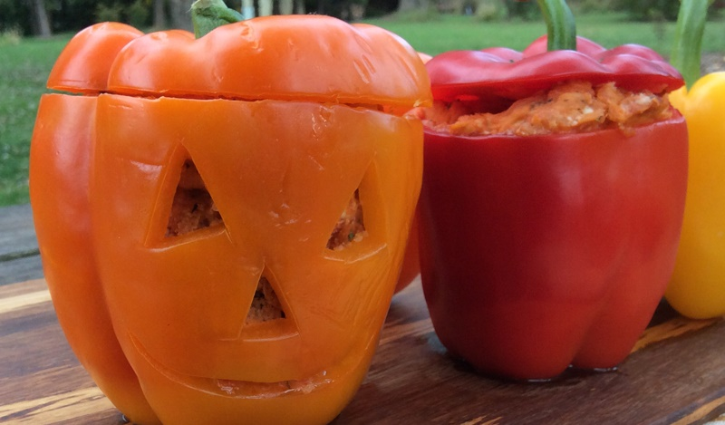 Bell Pepper Jack-O-Lanterns stuffed with Pulled Chicken Parmesan